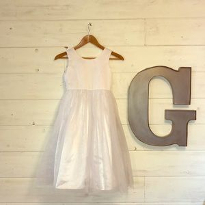 Jona Michelle girls white dress with underskirt.